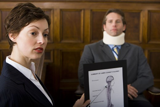 Stock Photo: 1660R-13159 A female lawyer pointing at evidence in front of a victim in a courtroom