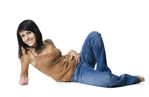 Stock Photo: 1660R-13255 Portrait of a young woman lying on her side