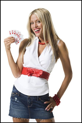 Stock Photo: 1660R-13362 Portrait of a young woman showing playing cards and smiling
