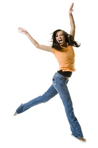 Portrait of a teenage girl jumping : Stock Photo