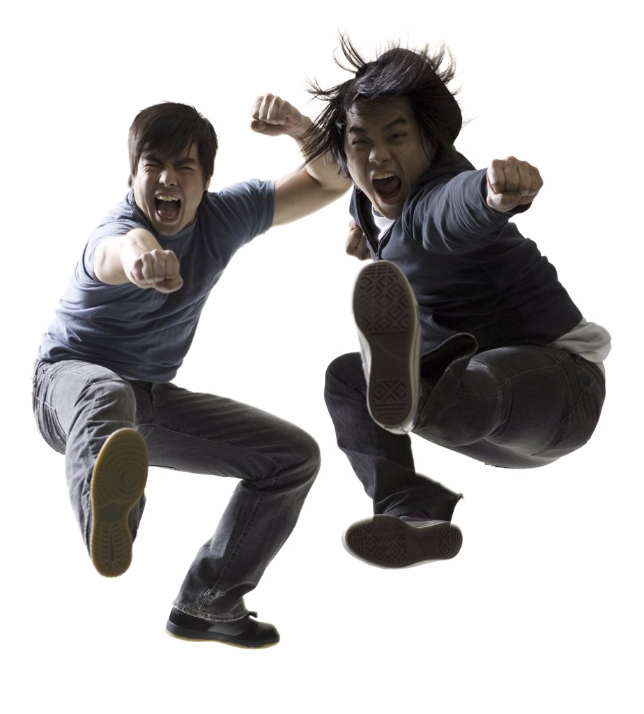 Stock Photo: 1660R-1346 Portrait of two young men jumping and kicking