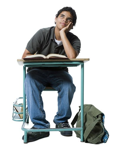 Stock Photo: 1660R-13469 Teenage boy thinking with his hand on his chin