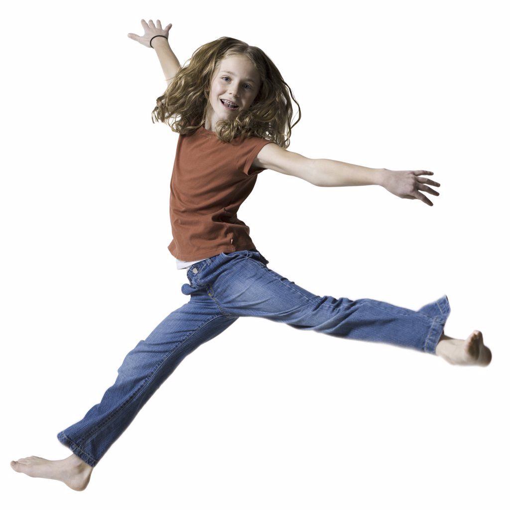 Portrait of a teenage girl jumping with her arms outstretched : Stock Photo