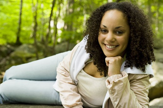 Stock Photo: 1660R-13542 Portrait of a young woman smiling