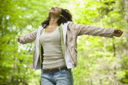Close-up of a young woman with her arms outstretched : Stock Photo