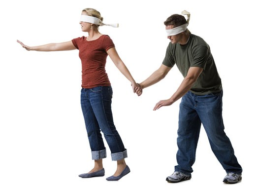 Stock Photo: 1660R-13711 Blindfolded young woman leading to a blindfolded young man