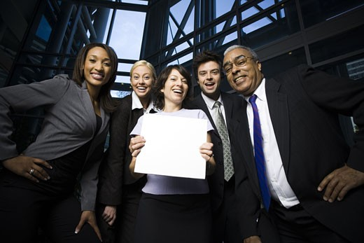 Stock Photo: 1660R-13727 Portrait of five business executives standing with a blank sign