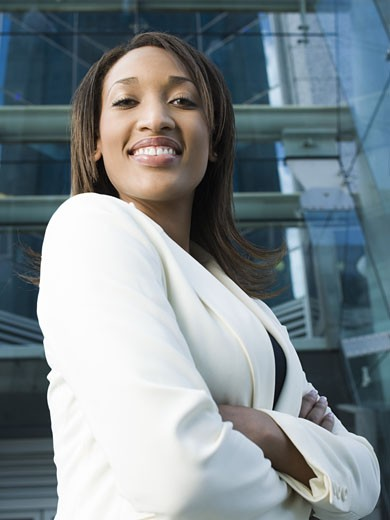 Stock Photo: 1660R-13744 Portrait of a young businesswoman standing in front of a building