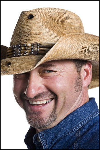 Smiling cowboy : Stock Photo