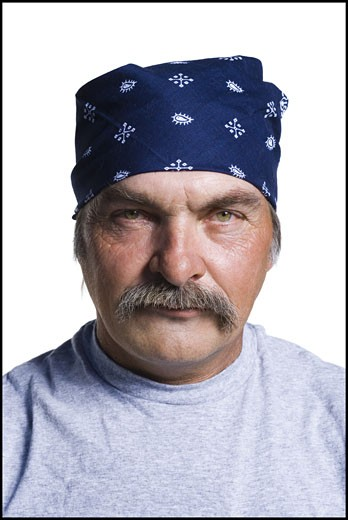 Disheveled middle aged man with head scarf : Stock Photo