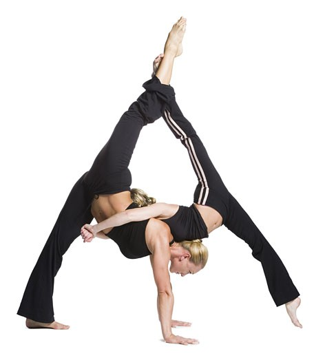 Female contortionist duo performing : Stock Photo