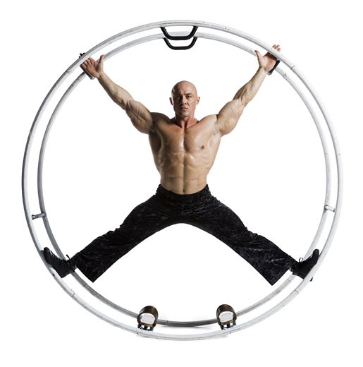 Stock Photo: 1660R-13981 Male bodybuilder posing in German wheel