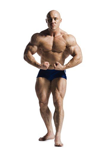 Male bodybuilder posing : Stock Photo