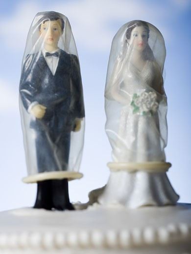 Stock Photo: 1660R-14053 Wedding cake visual metaphor with figurine cake toppers