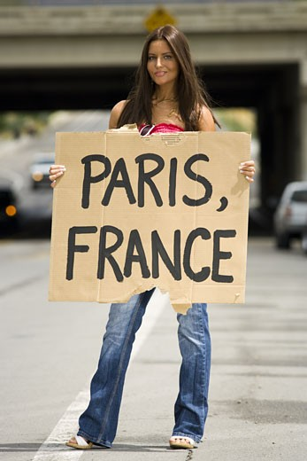 Woman hitchhiking a ride to Paris : Stock Photo