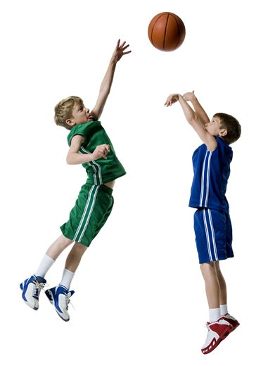 Young boys playing basketball : Stock Photo