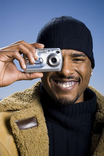 Stock Photo: 1660R-14530 African American taking picture with digital camera