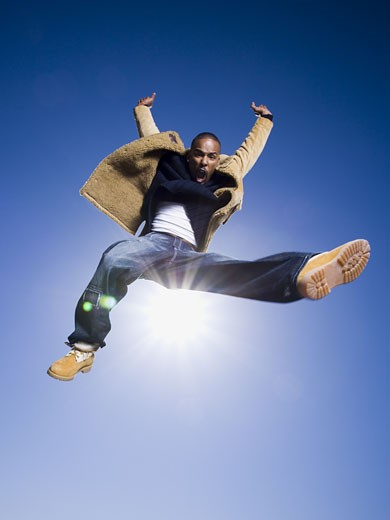 Stock Photo: 1660R-14536 African American man jumping