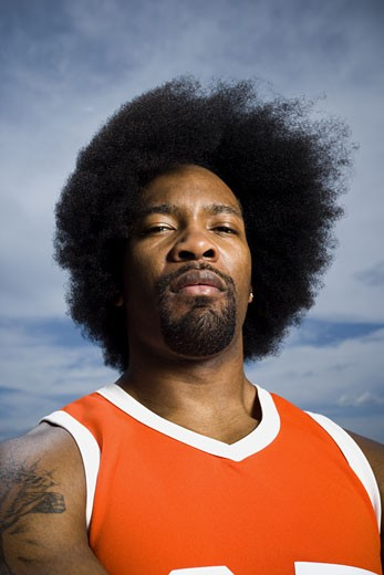 Stock Photo: 1660R-14633 Basketball player with an afro in orange uniform