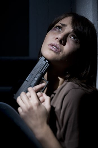 Depressed and suicidal young woman : Stock Photo