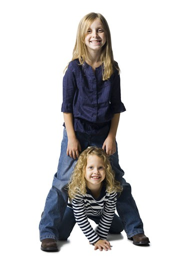 Two girls playing together : Stock Photo