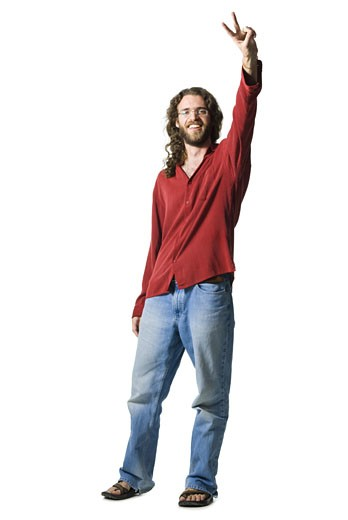 Man with long hair and beard making peace gesture : Stock Photo