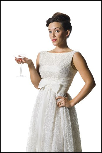 Stock Photo: 1660R-15269 Woman in white dress holding martini glass