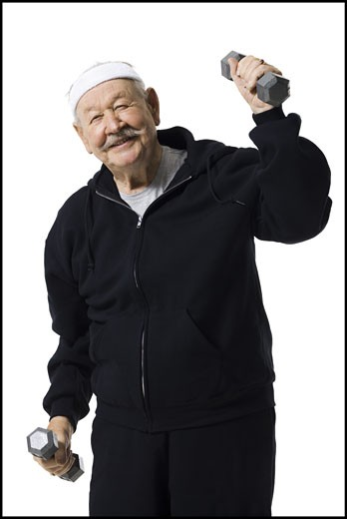 Stock Photo: 1660R-15438 Older man doing dumbbell exercises