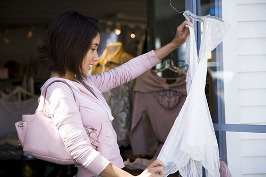 Woman shopping for clothes : Stock Photo