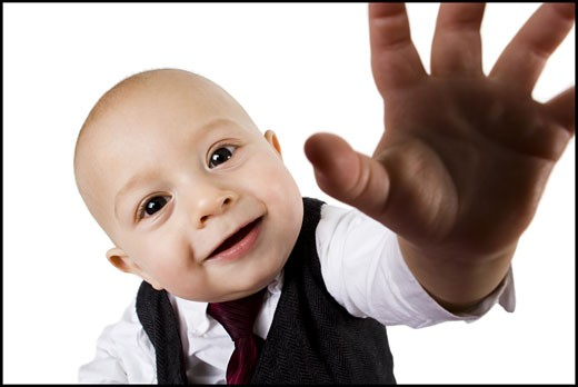 Stock Photo: 1660R-16207 Baby boy in business suit reaching