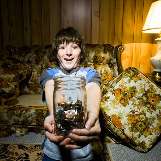 Stock Photo: 1660R-16389 Boy with coin jar smiling