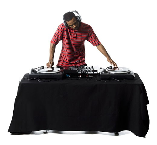 Stock Photo: 1660R-16401 DJ with headphones spinning records