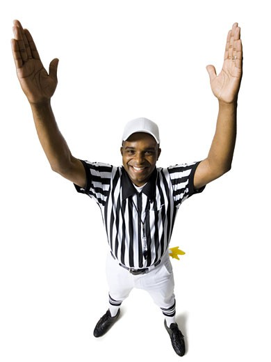 Stock Photo: 1660R-16445 Referee touchdown signal smiling