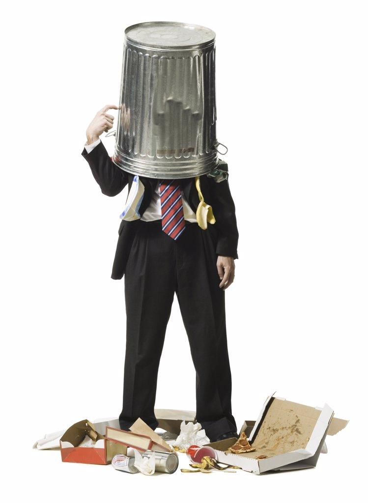 Stock Photo: 1660R-16544 Businessman with trash can on head