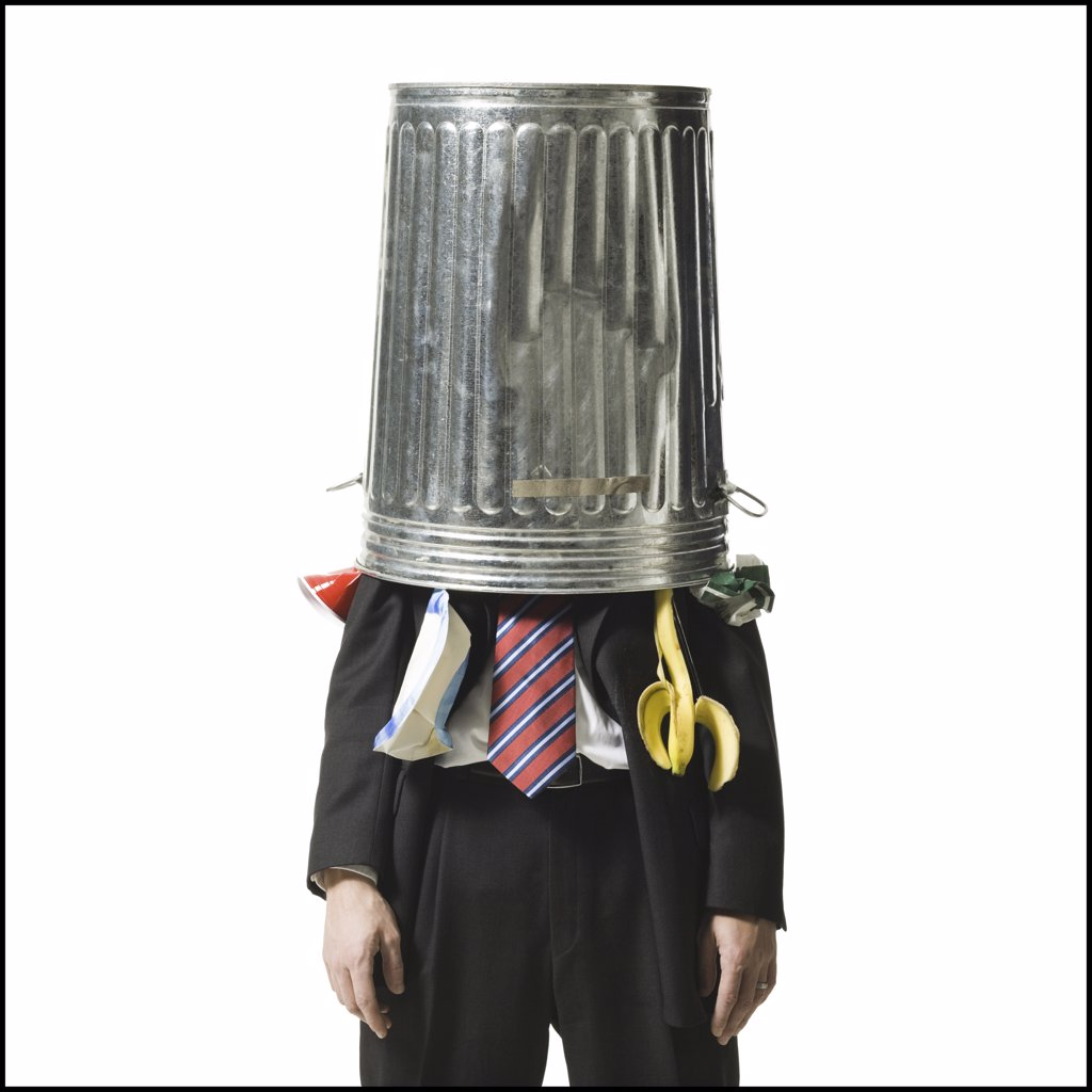 Businessman with trash can on head : Stock Photo