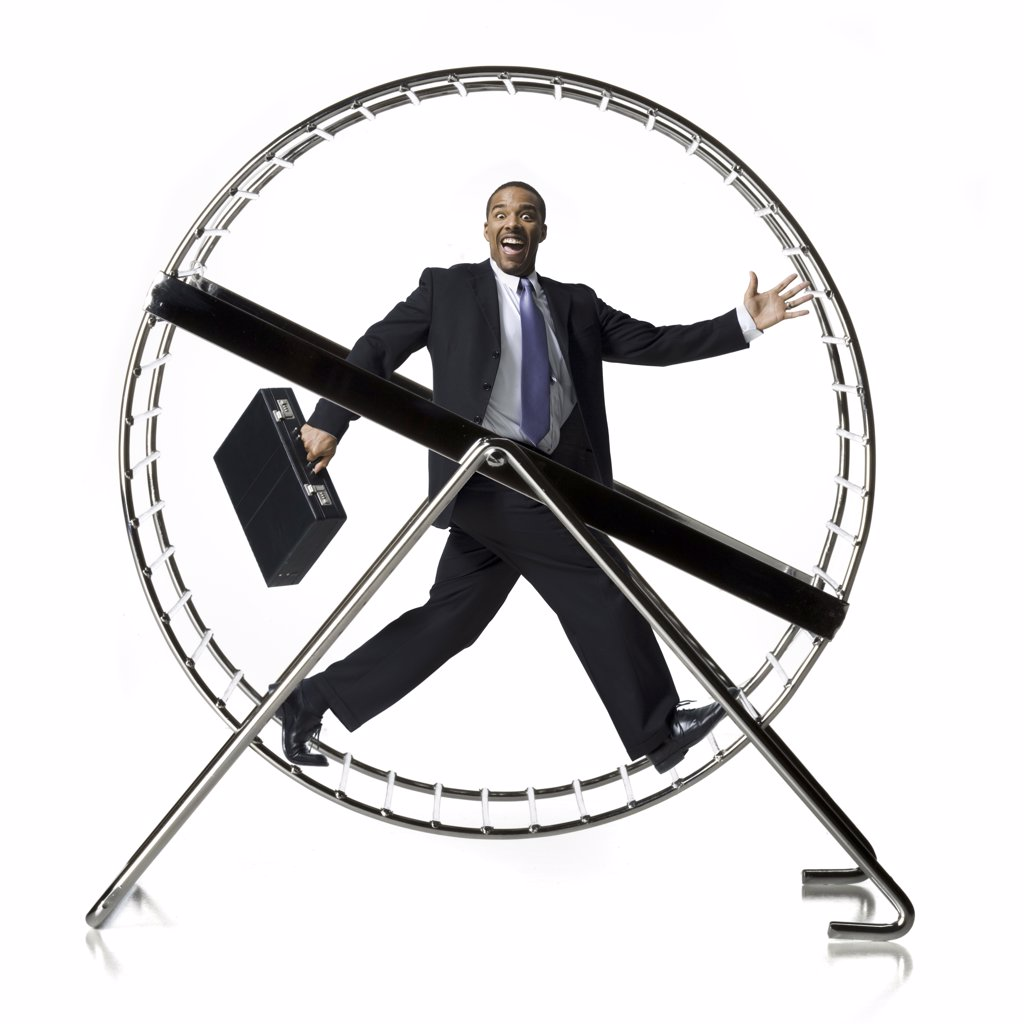 Stock Photo: 1660R-16560 Businessman in rodent wheel smiling
