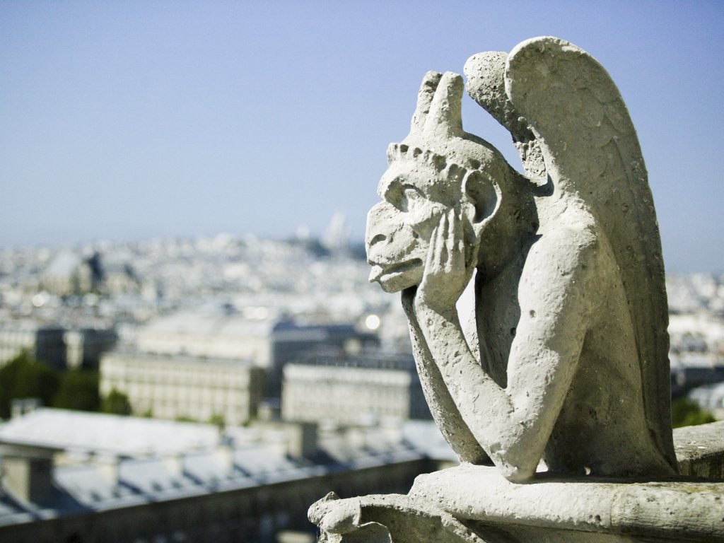 Gargoyle atop building : Stock Photo