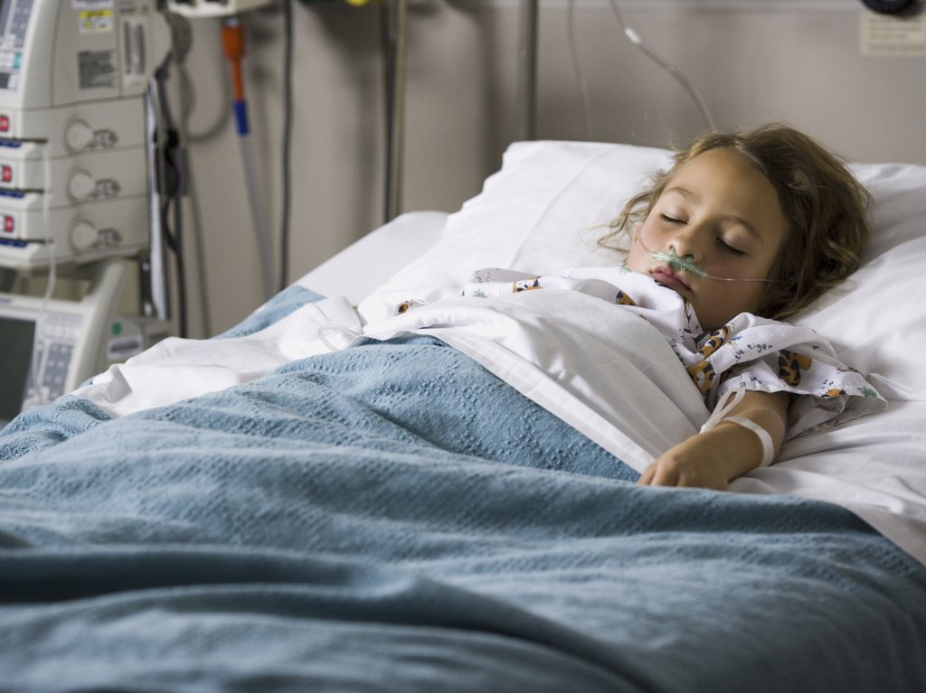 Stock Photo: 1660R-17170 Young girl in hospital bed with respirator