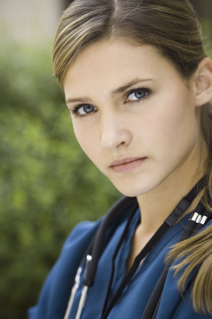 Stock Photo: 1660R-17200 Portrait of a female nurse outdoors with stethoscope