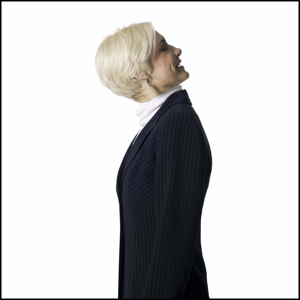 Stock Photo: 1660R-17270 Profile of a mature businesswoman with head on backwards