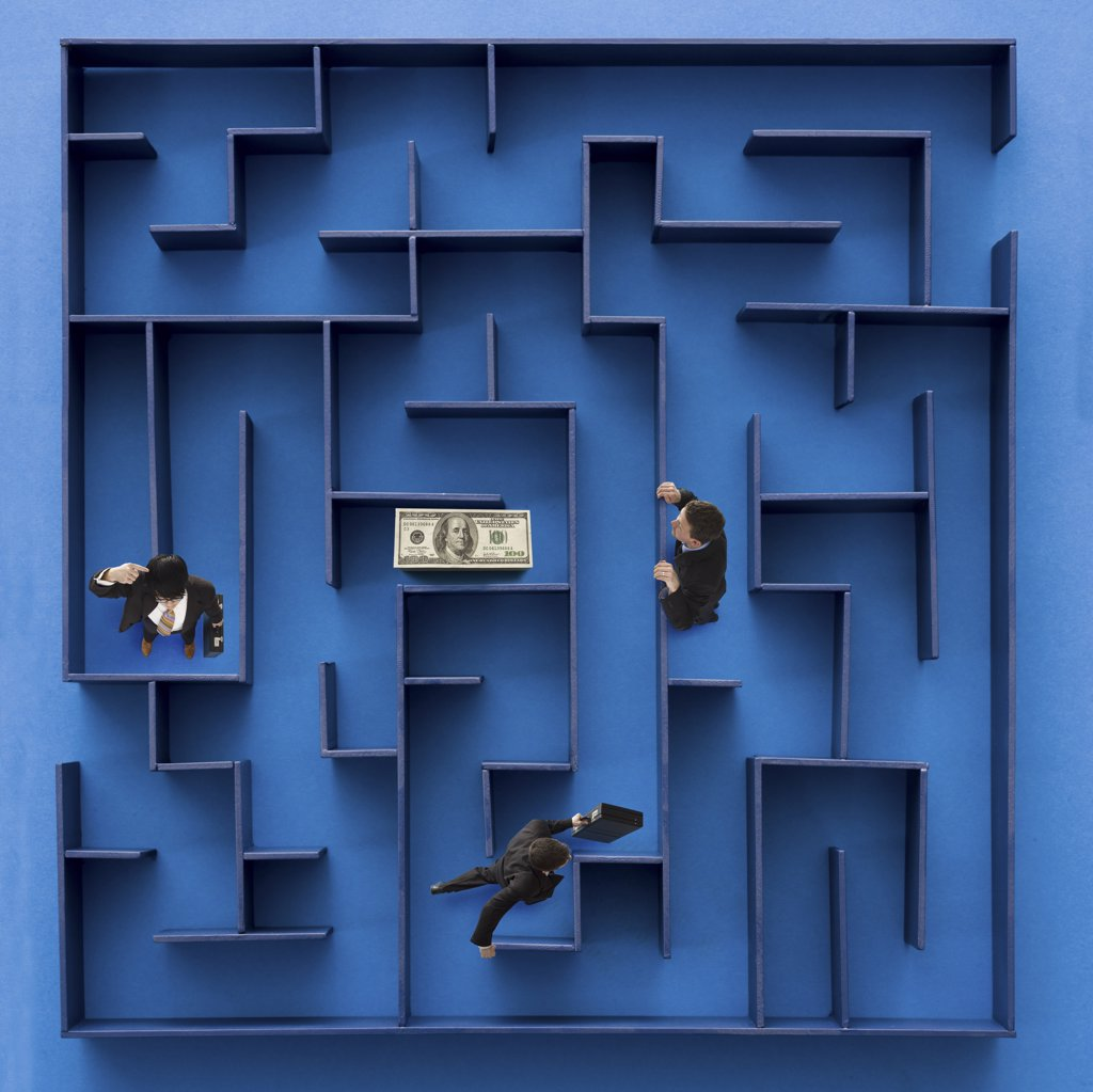 Three businessmen in maze with American money : Stock Photo