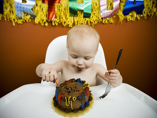 Stock Photo: 1660R-17803 Baby eating birthday cake