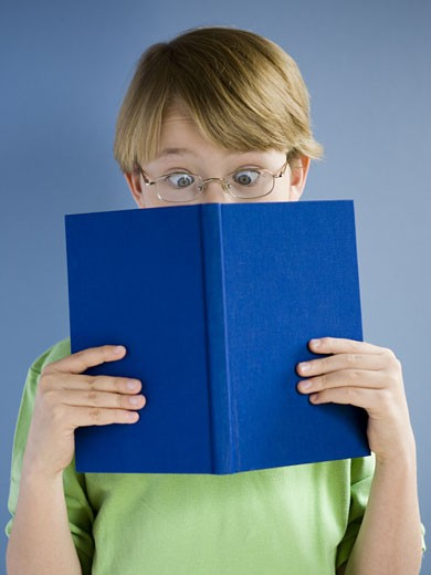 Stock Photo: 1660R-18218 Boy with hardcover book