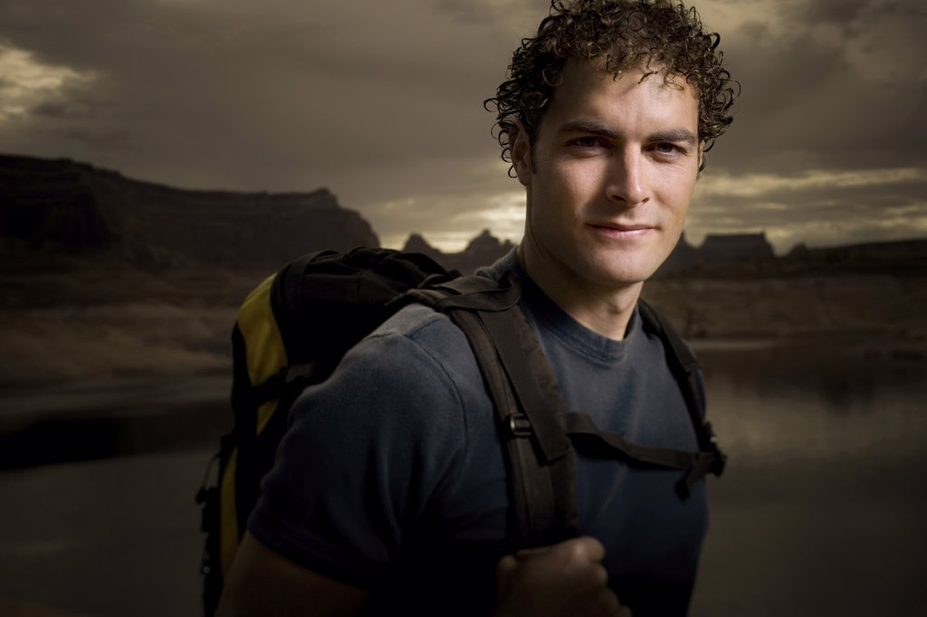 Stock Photo: 1660R-1839 Portrait of a young man carrying a backpack