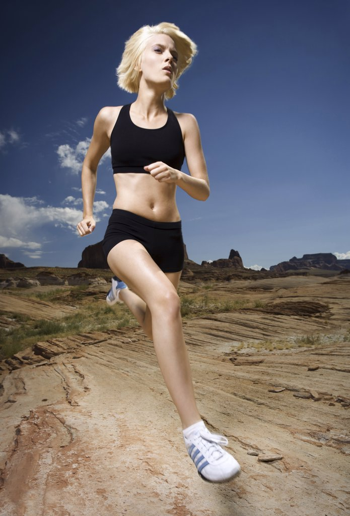 Stock Photo: 1660R-1844 Low angle view of a young woman jogging