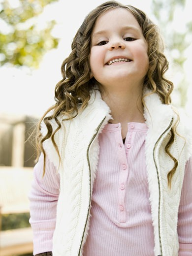 Stock Photo: 1660R-18743 Portrait of a girl smiling outdoors