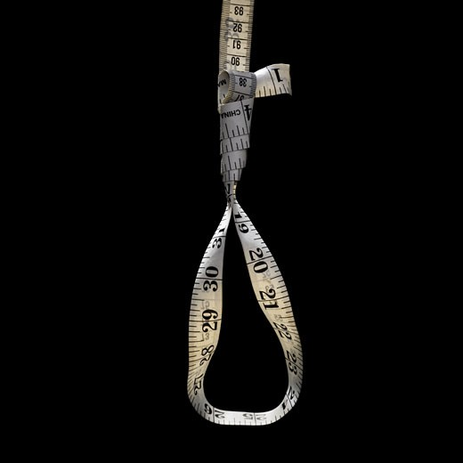 Tape measure forming noose : Stock Photo