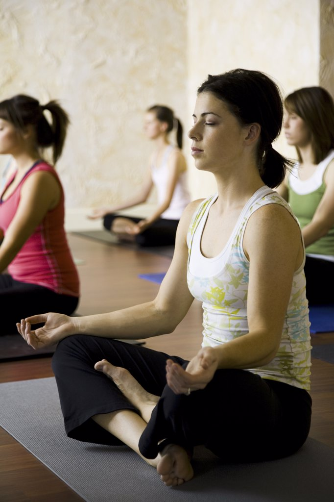 Stock Photo: 1660R-19532 Women at yoga class