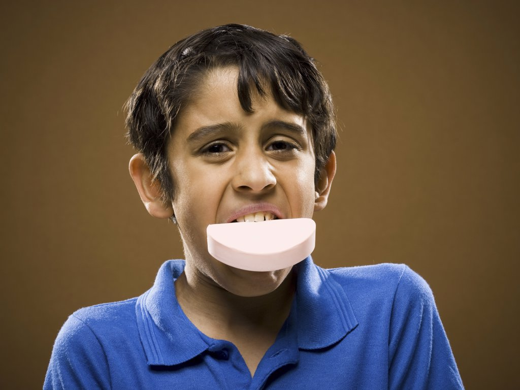 Stock Photo: 1660R-19565 Boy with bar of soap in mouth