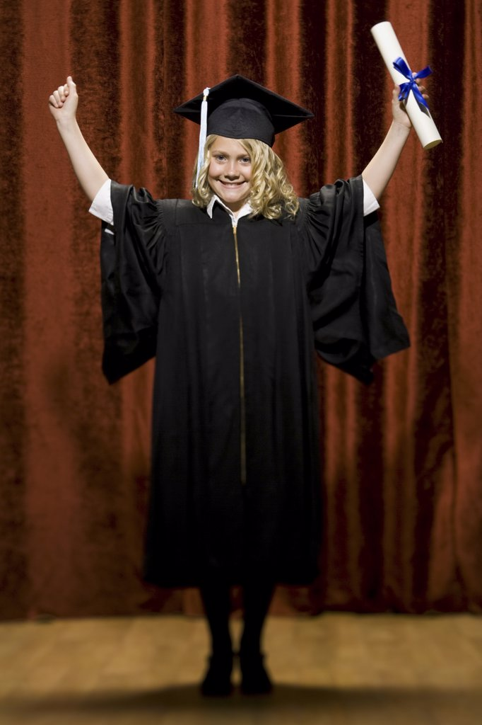 Girl graduate with mortar board and diploma smiling and cheering : Stock Photo